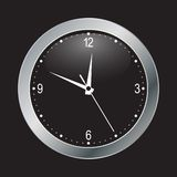 Black clock on black background Stock Photo