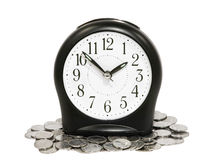 Black clock and coins. Royalty Free Stock Photography