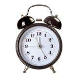 Black clock isolated. Black analog clock isolated over white background Royalty Free Stock Photos