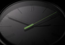 Black clock. Macro image of black handwatch Stock Photography