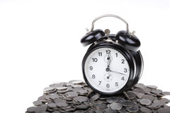 Black clock on a money Royalty Free Stock Photo