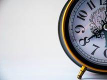 Black clock shows 8 am, alarm clock stock photo