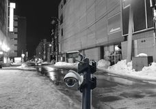Black close circuit television on night scene of footpath in alley at Hokkaido Japan. Black close circuit television on ther night scene of footpath in alley at royalty free stock photo