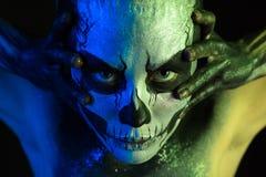 Beautiful creepy girl with skeleton makeup royalty free stock photography