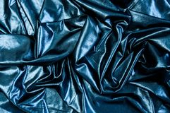 Black blue cloth waves abstract textile background. Fabric as pitch oil. Dark wallpaper. royalty free stock image