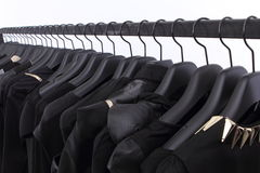 Black clothes on shelf Royalty Free Stock Images