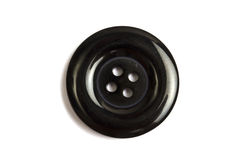 Black clothing button isolated on white Stock Photography