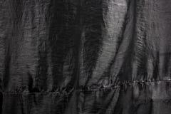 Black clothing texture background. Black color clothing texture background Stock Photo