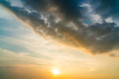 Black Cloud Storm in the sky at sunset.  Royalty Free Stock Image