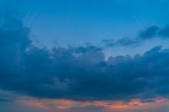 Black Cloud Storm in the sky at sunset.  Stock Images