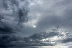 Black clouds are overshadowing the sun. Royalty Free Stock Photo