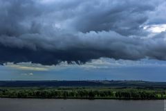 Black clouds pass over the river Stock Image