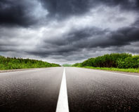 Black clouds and road Stock Image