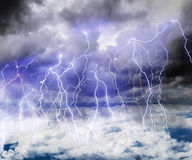 Black clouds in the sky full of lightning in a thunderstorm. Black clouds in the sky full of lightning in a thunderstorm with a roll of Thunder stock photos