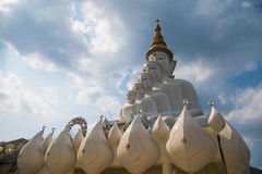 Black clouds  sky and white buddha statue. Large buddha statue in Phasonkhaw Temple,Thailand Royalty Free Stock Image