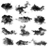 Black clouds or smoke. On a white background Stock Photos