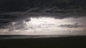 Black clouds. Storm threat on the Gurugu´s beach in Castellon Spain royalty free stock image