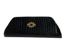 Black clutch bag with studded stones Royalty Free Stock Photos