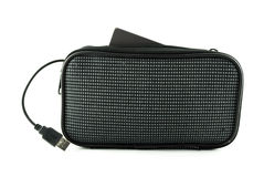 Black clutch bag and USB cable wire Royalty Free Stock Photography