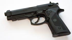 Black CO2 pistol. Isolated on white background stock photos
