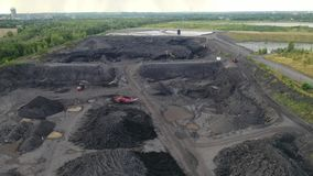Black coal ask, elimination of the aftermath of black - aerial view by drone