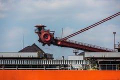 Black coal crane loading machine royalty free stock images