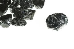 Black coal mine close-up with large depth of field. Anthracite coal bar isolated on white background Stock Photography