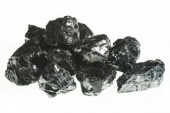 Black coal mine close-up with large depth of field. Anthracite coal bar isolated on white background.  Stock Photo