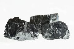 Black coal mine close-up with large depth of field. Anthracite coal bar isolated on white background Stock Image