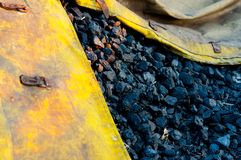 Black coal in yellow bag Stock Images