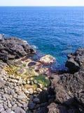 Black coastline with lava cliffs in Catania Royalty Free Stock Photos