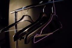 Black coat hanger in the dark. A black coat hanger in the dark Royalty Free Stock Image