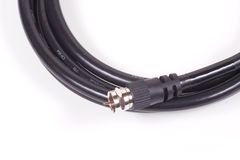 Black Coaxial Cable 2. A black coaxial cable on a white background royalty free stock photography