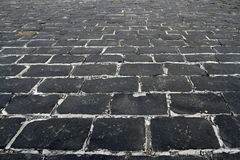 Black cobblestone background in perspective Royalty Free Stock Image