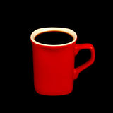 Black coffe. A red mug with black coffe on a black royalty free stock images
