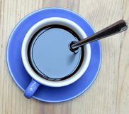 Black coffe. In a blue cup royalty free stock photography