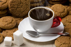 Black coffee. Sugar and oatmeal cookies Stock Photo
