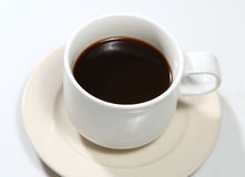 Black coffee. Closeup image of hot black coffee on white table Royalty Free Stock Photography