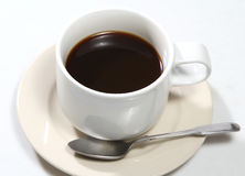 Black coffee. Closeup image of hot black coffee on white table stock image