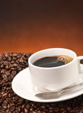 Black coffee. With spoon and bean Royalty Free Stock Photo
