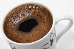 Black coffee. Beautiful white cup with strong black coffee royalty free stock image
