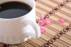 Black coffee. With pental on mat Royalty Free Stock Image