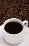 Black coffee. (white cup and coffee grain Royalty Free Stock Image