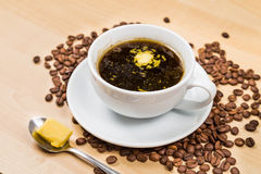 Black coffee with added butter Royalty Free Stock Images