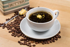Black coffee with added butter.  stock image