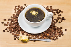 Black coffee with added butter.  royalty free stock images