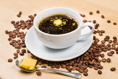 Black coffee with added butter Royalty Free Stock Photos