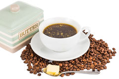 Black coffee with added butter.  stock photography