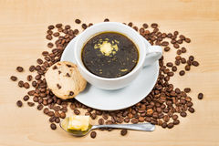 Black coffee with added butter, accompanied with butter cookie Stock Image