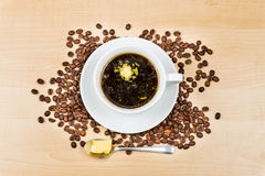 Black coffee with added butter, accompanied with butter cookie Royalty Free Stock Photography